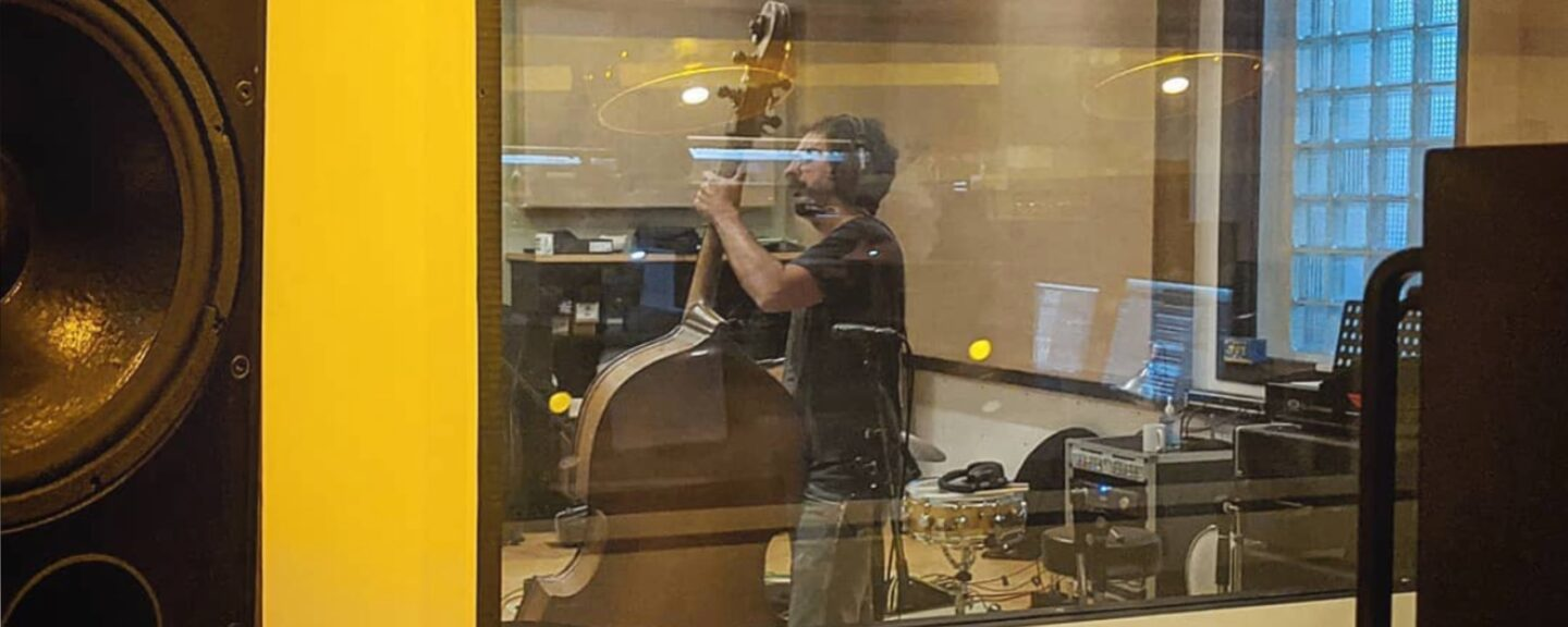 Double bass player in the recording studio